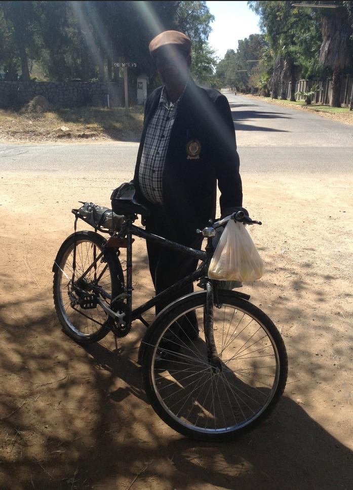 A picture of a man and a bike in Zimbabwe