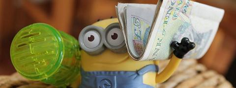 A picture of a minion with money