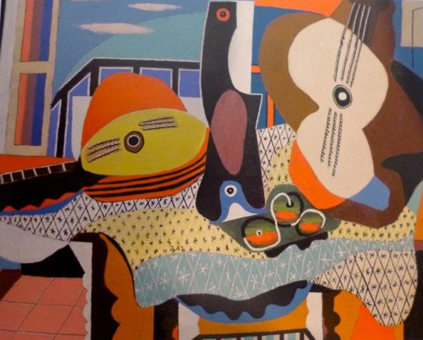 A picture of Picasso 's 'Guitar and Mandolin on a Table'