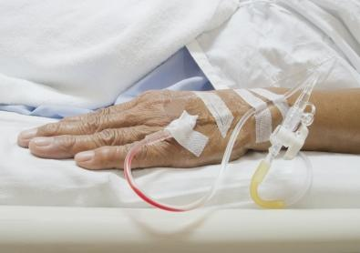 A picture of an old person's hand with iv drips by freedigitalphotos.net/olovedog