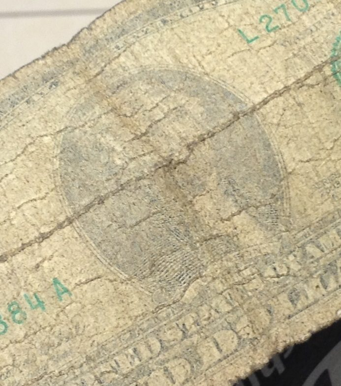 A dollar bill, very faded