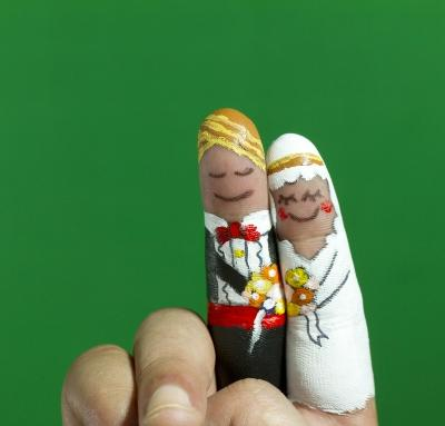 A picture of fingerpainted wedding couple