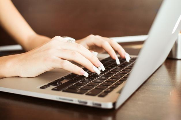A picture of a woman typing by Vickto Hanacek