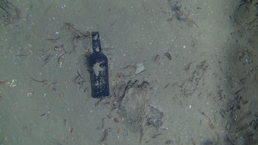 glass bottle in shipwreck by WHOI