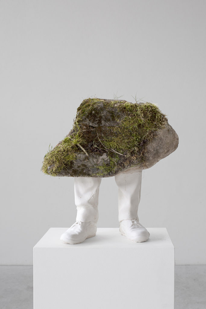 sculpture of a stone with legs